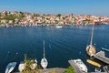 Sailboats At The Jetty On A Seaside Village Stock Photography - 54788672