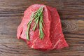 Raw Beef Steak With Rosemary Royalty Free Stock Photos - 54791618