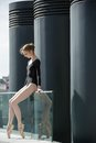 Young Graceful Ballerina In Black Bathing Suit On Stock Photography - 54796872
