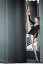 Young Graceful Ballerina In Black Bathing Suit On Stock Photos - 54796923