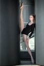 Young Graceful Ballerina In Black Bathing Suit On Stock Photos - 54797213