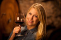 Beautiful Young Blond Woman Tasting Red Wine In A Wine Cellar Stock Images - 54805474