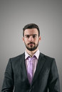 Portrait Of Young Serious Businessman With Intense Look At Camera Stock Images - 54810844