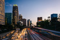 Traffic On The 110 Freeway And The Los Angeles Skyline At Sunset Stock Photo - 54820770