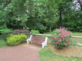 Empty Bench At Butterfly Garden In Roosevelt Park, Edison, NJ, USA. Г. Stock Photos - 54824473