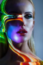 Portrait Of Blond Woman With Shining Lights On Face Royalty Free Stock Images - 54851719
