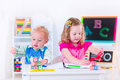 Adorable Kids At Preschool Painting Royalty Free Stock Images - 54857289