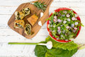 Swiss Chard Rolls On Chopping Board With Lettuce Rocket Radishes Royalty Free Stock Photo - 54865695