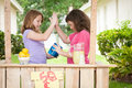 Two Young Girls High Fiving Royalty Free Stock Photography - 54866287