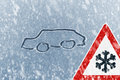 Winter Driving - Snow On An Ice Covered Windshield With Sketched Car And Warning Sign Royalty Free Stock Photos - 54871048