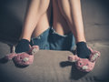Young Woman Wearing Bunny Slippers At Home Royalty Free Stock Photos - 54879948