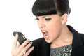 Angry Frustrated Annoyed Woman Shouting Into Cell Phone Stock Photo - 54880350