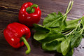 Red Bell Peppers And Spinach. Royalty Free Stock Images - 54883389