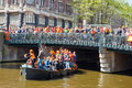 AMSTERDAM-APRIL 27:  King S Day Also Known Koningsdag Boating On The Singel Canal On April 27, 2015, The Netherlands. Royalty Free Stock Photos - 54902698