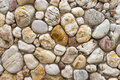 Pebble Stones In A Bright Stone Wall Stock Photography - 54903752