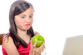 A Little Girl Does Not Like Apples Stock Photos - 54914623
