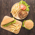 Hot Dogs, Hamburgers And Grilled Pork Chop Steak On The Wooden Background. Stock Photos - 54919643