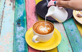 Pour Milk To Coffee Cup Stock Photo - 54935800