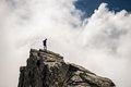 Hiker Standing High Up On Rocky Mountain Peak Stock Image - 54945581