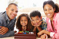 Mixed Race Family Playing Solitaire Royalty Free Stock Photo - 54951735