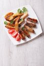 Pork Ribs, Potatoes And Tomatoes On A Plate Top View Vertical Stock Image - 54958581
