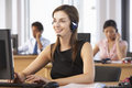 Friendly Customer Service Agent In Call Centre Royalty Free Stock Images - 54964219