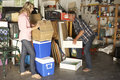 Couple Clearing Garage For Yard Sale Royalty Free Stock Photos - 54964588