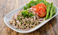 Spicy Minced Pork On Plate With Wood Table Stock Photos - 54970923