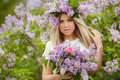 Spring Portrait Of A Beautiful Girl With Lilac. Royalty Free Stock Photography - 54975147