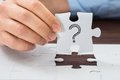 Person Hand Holding Puzzle With Question Mark Royalty Free Stock Images - 54982219