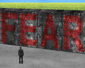 Man Facing Red Fear Word On Huge Concrete Puzzles Connected Royalty Free Stock Photo - 54996435