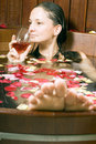 Woman With Wine In Tub - Vertical Stock Images - 5509584