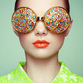 Portrait Of Beautiful Young Woman With Colored Glasses Royalty Free Stock Photo - 55011045