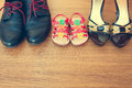 Three Pairs Of Shoes: Men, Women And Children. Stock Images - 55013144