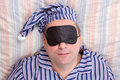 Man Sleeping With A Mask On Eyes Stock Photography - 55019202