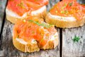 Appetizer Canapes Of Baguette With Smoked Salmon Royalty Free Stock Images - 55034419