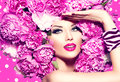 Beauty Girl With Pink Peony Hairstyle Royalty Free Stock Image - 55058846