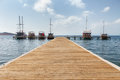 Boats At The End Of The Pier On The Sea Stock Photography - 55065692
