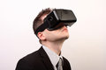 Side View Of A Man Wearing A VR Virtual Reality Oculus Rift 3D Headset, Looking Upwards In A Black Official Suit Stock Image - 55069051