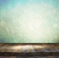 Rustic Wood Table In Front Of Glitter Silver, Blue, And Gold Bokeh Lights Royalty Free Stock Photos - 55071578
