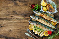 Grilled Mackerel Fish With Baked Potatoes Stock Photos - 55095633
