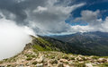 Clouds Meet The Top Of A Mountain Ridge On GR20 In Corsica Royalty Free Stock Photo - 55110925