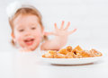 Happy Child  Girl Eats Cookies And Milk Royalty Free Stock Images - 55126139