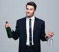 Businessman Holding Bottle With Champagne And Glass Stock Photo - 55131210