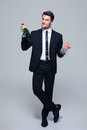 Businessman Holding Bottle With Champagne And Glass Stock Photos - 55131553
