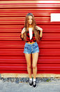 Full Length Portrait Of Trendy Hipster Girl Standing At The Red Royalty Free Stock Images - 55141029