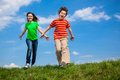 Girl And Boy Jumping Royalty Free Stock Image - 55150126