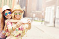 Two Happy Girl Friends Taking Selfie Royalty Free Stock Images - 55152719