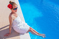 Woman Wearing Towel With Feet In Swimming Pool Stock Photography - 55177472