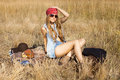 Hippie Girl Preparing To Have Picnic On A Meadow Royalty Free Stock Photography - 55181027